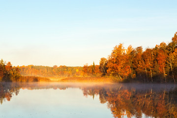 Aluminium Prints Autumn View of a lake with mist at dawn in the autumn