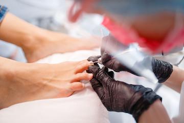 Cosmetologist salon, pedicure, polish procedure