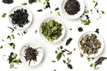 Fototapeta Various dry seaweed, sea vegetables, shot from the top on a white background. Superfoods background obraz
