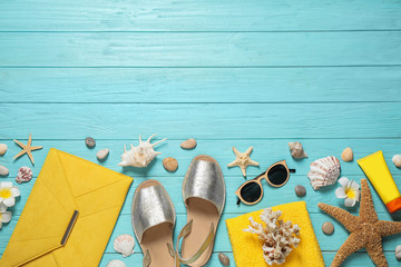 Flat lay composition with stylish beach accessories on light blue wooden background, space for text Wall mural