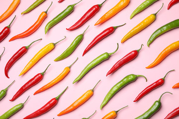 Canvas Prints Hot chili peppers Different colorful chili peppers on light pink background, flat lay