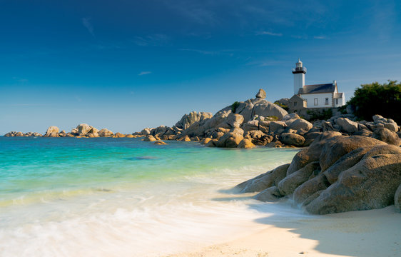 view of the Pontusval lighthouse and bay on the north coast of Brittany in France