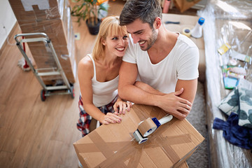 couple with boxes – Man and woman moving into a new home..