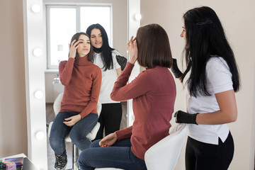 woman making eyebrow cosmetic procedure. Eyebrow shaping master service her client female.