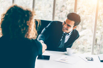 Business interview concept - Businessman and woman making handshake in office
