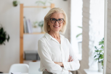 Portrait of smiling senior businesswoman posing for picture