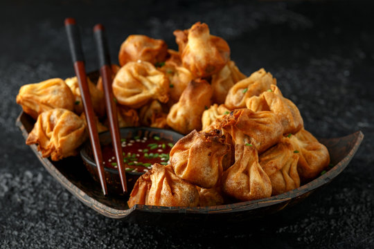 Chinese takeaway finger food Vegetable wontons with sweet chilli dip sauce and chop sticks