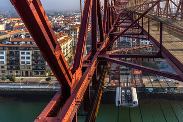 The gondola of Vizcaya Bridge carrying cars and passengers viewed form top, Portugalete, Basque Country, Spain