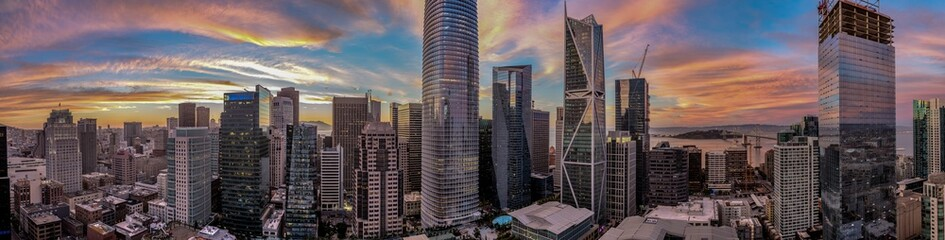 Panorama of San Francisco skyline with amazing pink red and blue sunset focusing on the Salesforce Tower in the center
