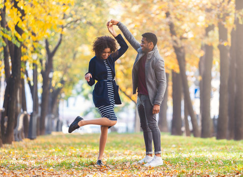 Couple in love dancing together in autumn park