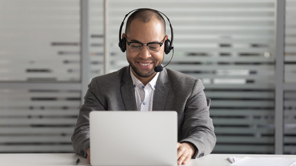 Cheerful african american support service male worker consulting corporate customer.