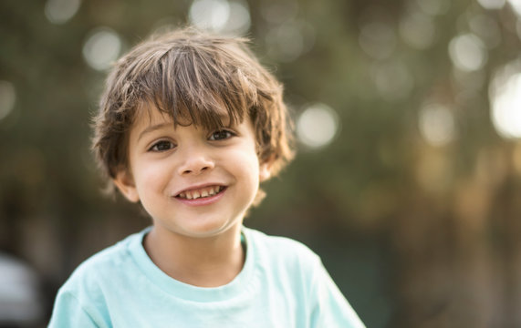 little three years old boy portraits in summer afternoon