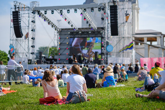 Couple is watching concert at open air music festival