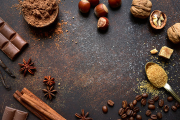 Culinary background with ingredients for baking chocolate cookies or cake. Top view with copy space.