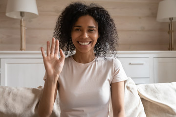 Happy biracial woman wave talking on video call