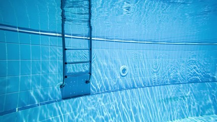 Fototapete - Ladder pool Swimming pool underwater background.