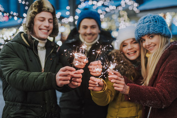 Fototapete - Group of young people celebrating New Year