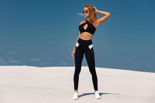Beautiful athletic girl in sportswear, fitness woman in leggings outdoor