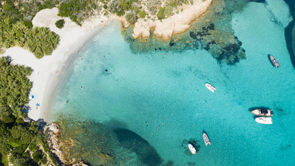 Wall Mural - View from above, stunning aerial view of some boats and luxury yachts floating on a turquoise water. Maddalena Archipelago National Park, Sardinia, Italy.