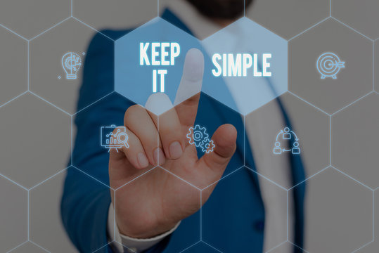Text sign showing Keep It Simple. Business photo text to make something easy to understand and not in fancy way Male human wear formal work suit presenting presentation using smart device