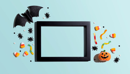Halloween theme decoration with photo frame - overhead view flat lay