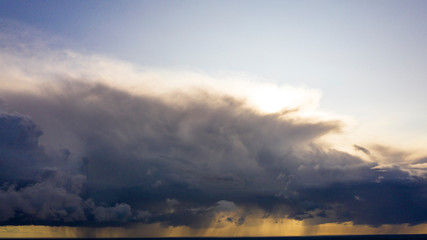 Aerial image of dark Storm clouds over the land. Aerial panorama of storm clouds. Panorama of...