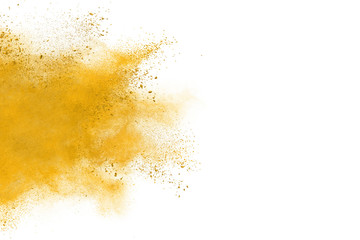 Yellow powder explosion on white background. Colored cloud. Colorful dust explode. Paint Holi.
