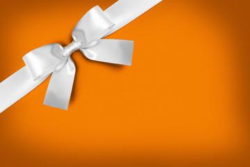 Wall Mural - White gift bow on orange