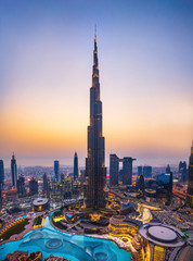 Dubai, United Arab Emirates - July 5, 2019: Burj khalifa rising above Dubai mall and fountain surrounded by modern buildings top view