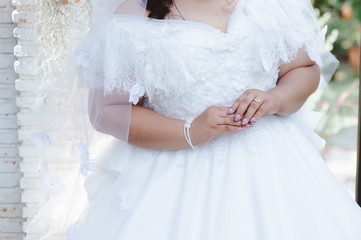 Happy overweight wedding dress and tuxedo or plus size newlywed or bride and groom take picture in bridal dress fitting room, healthy happy overweight newlywed concept