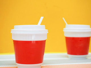 Wall Mural - Red coffee cup with  yellow background.Modern concept
