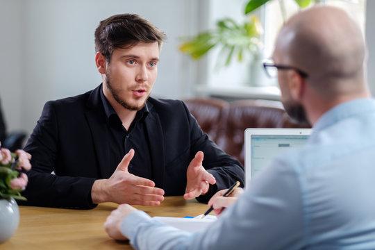 Confident young man attending job interview