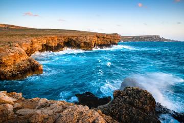 Fototapete - Rocky coast. Sea surf in bay with cliffs.