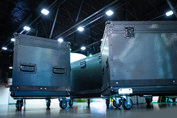 Concert boxes. Equipment for organizing concerts. Boxes on wheels. Transportation of musical equipment. Boxes for musical equipment. Musical electronics delivery. Black boxes for transportation.
