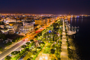 Photo sur Aluminium Chypre Republic of Cyprus. Night panorama of Limassol. View of Limassol from the drone. Illuminated promenade of the Mediterranean sea. Lanterns and palm trees on the waterfront. Trip to Cyprus.