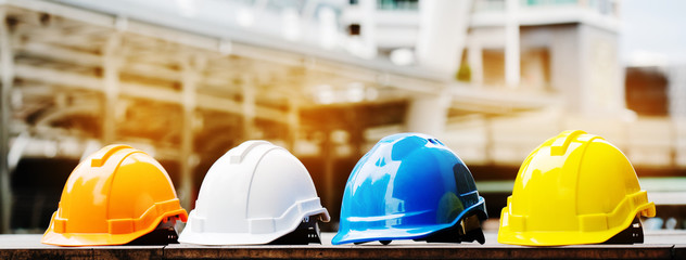 Quality contractor teamwork. Safety construction for engineer or building work site or plant. Wearing helmet and protective equipment can safe worker life in industrial work or plant. copy space