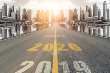 The number 2020 symbol represents the new year on the road heading to the city with beautiful...