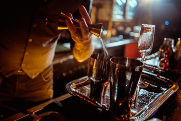 process of preparing a cocktail bartender