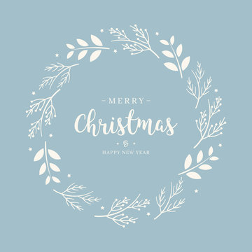 Merry Christmas greeting text branch  wreath circle blue background