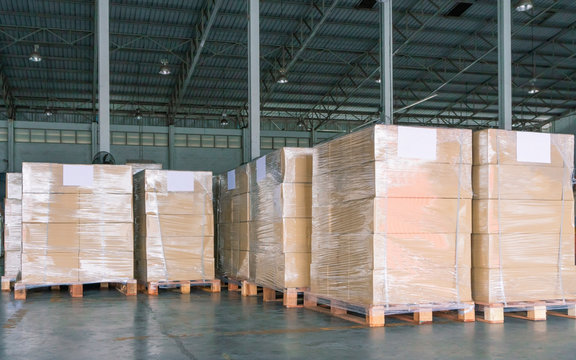 stack package boxes wrapping stretch plastic on pallet at storage warehouse, cargo shipment delivery, business industry transportation,