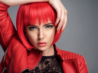 Fotobehang Kapsalon Beautiful sexy woman with bright red bob hairstyle. Fashion model. Sensual gorgeous girl in a leather jacket. Stunning face of a pretty lady.