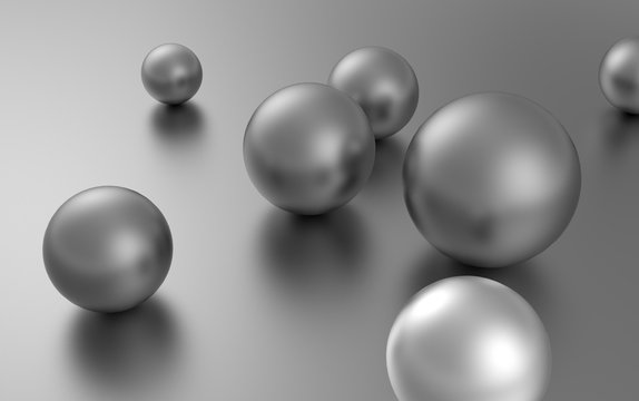 silver balls randomly scattered on the surface of a sphere of different sizes.