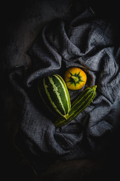 Overhead view of zucchini on fabric