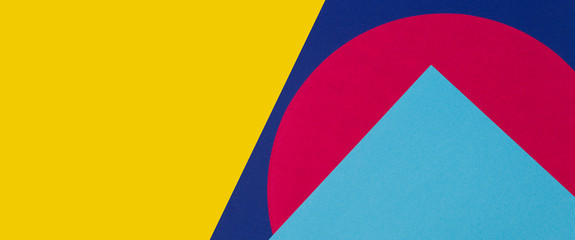 Texture background of fashion papers in memphis geometry style. Yellow, blue, light blue, red colors. Top view, flat lay
