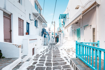 Typical Greek architecture in the white, cobbled alleys of Mykonos town, houses in the old town of...