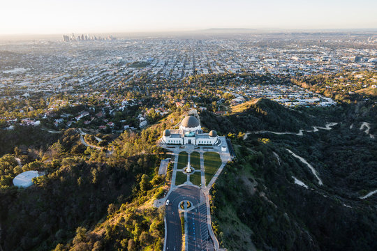 Early morning aerial above popular Griffith Park in Los Angeles, California.