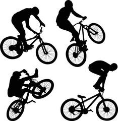 cyclist doing bike trick silhouettes