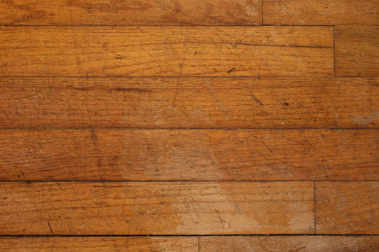 Weathered and damaged hardwood flooring, suitable for backgrounds or textures.