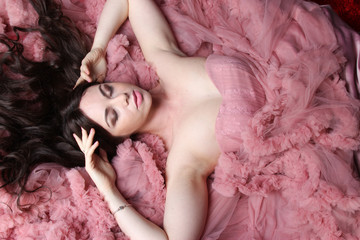 top view close up Portrait of fashionable young beauty girl in big long evening pink dress
