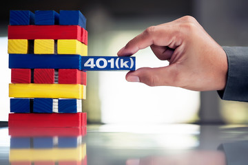 An employee carefully handling his 401k retirement plan to invest in a stocks, bonds, mutual funds, or other assets.